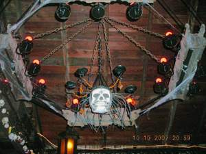 Chandelier with cobwebs and skeleton mask