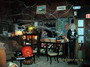 Decorated waiting area with pumpkins and cobwebs